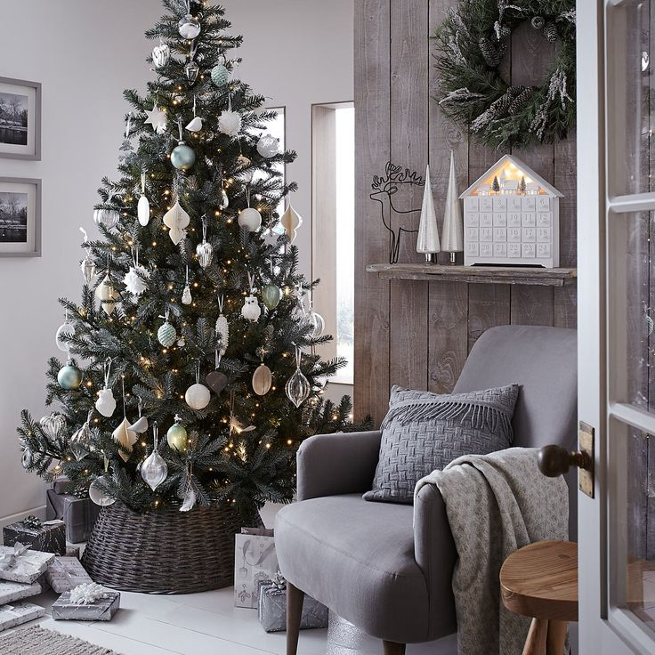 A neutral grey colour palette adds to the frosty winter atmosphere, bringing the Christmas tree and pine branch accents to life.