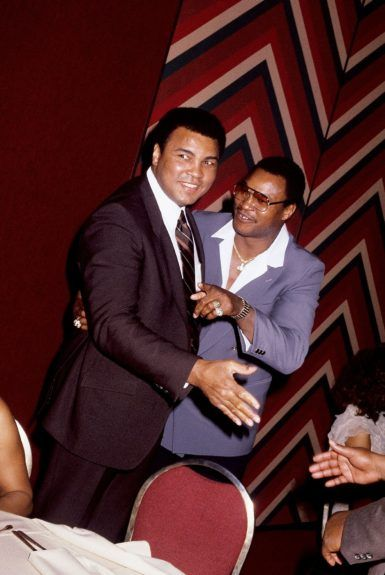 <p> Three-time heavyweight champion Muhammad Ali is photographed with fellow boxer Larry Holmes in 1985. (Isaac Sutton/Ebony Collection)</p>