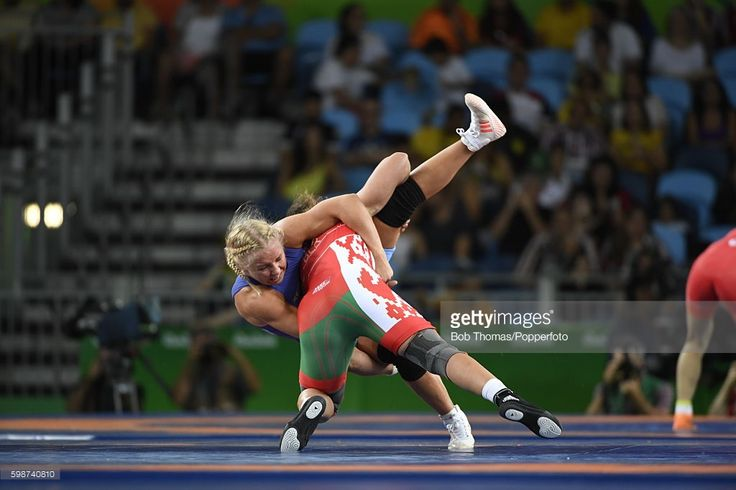 Maryia Mamashuk of Belarus (red) competes against Henna Katarina Johansson of Sweden during the Women's Freestyle Wrestling 63 kg Quarterfinals on Day 13 of the Rio 2016 Olympic Games at Carioca Arena 2 on August 18, 2016 in Rio de Janeiro, Brazil. (Photo by Bob Thomas/Popperfoto/Getty Images).