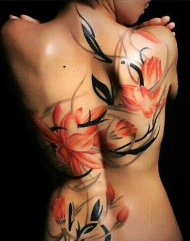Full back flower tattoo in red and black
