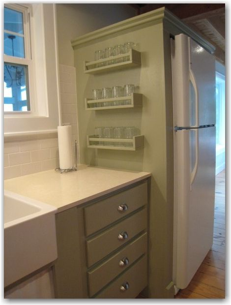 If you like your glasses as close as possible to your kitchen's water source, use an IKEA spice rack to hang 'em on the cabinet closest to your sink. Your thirst will thank you. Click through for more on this and other kitchen IKEA hacks.