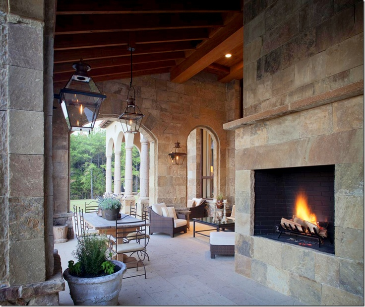 Slate Tiles With Arches And Over Sized Fireplace