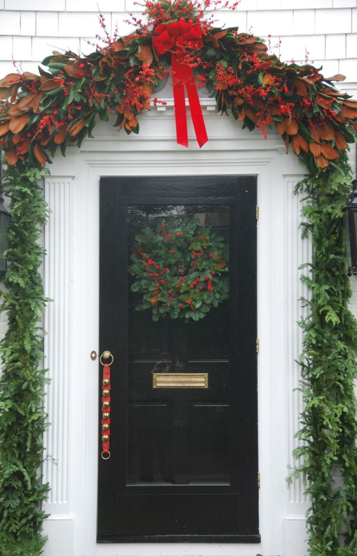 Front door christmas wreaths - Berries Magnolia Branches Make A Beautiful Display At The Front Door Christmas Door Christmas Wreaths