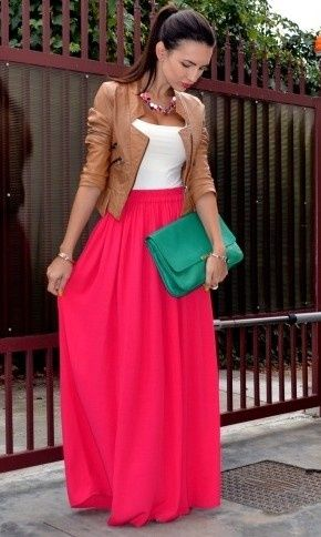 pink maxi skirt, white top and leather jacket with turquoise clutch.