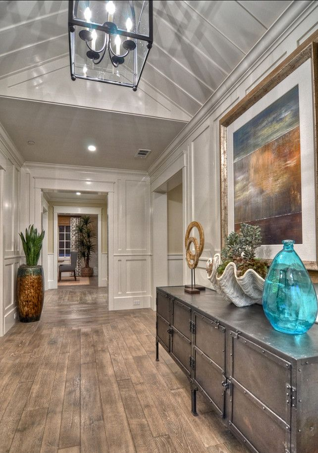 The floors! Coastal Inspired entryway with engineered white oak hardwood flooring. Flooring is an engineered 5/8″ wire brushed white oak.