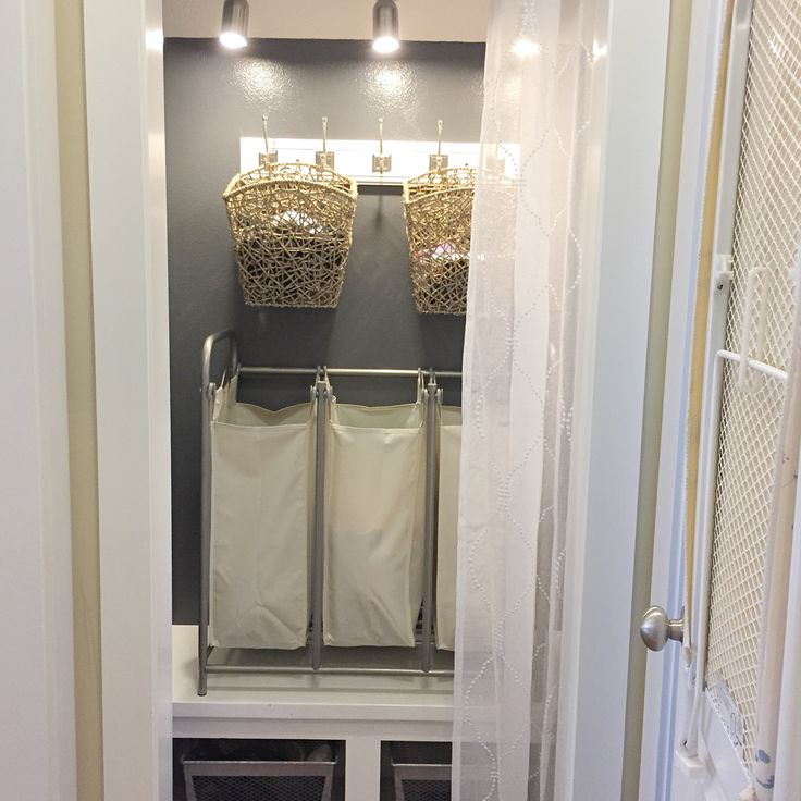 I converted the unused built-in entry nook to a laundry sorting station. It is directly across from the small laundry room with no place to sort clothes. Baskets for single socks, shoe bins at the bottom, curtain rod and semi-sheer curtain to hide laundry and look pretty when guests are over.