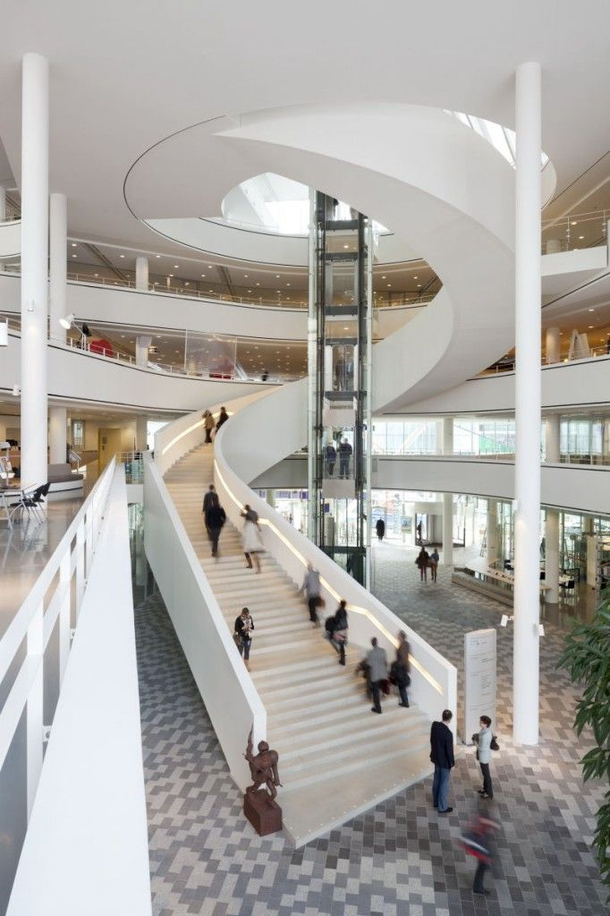 """""""The five floors spread out like a fan and open up towards the atrium, allowing the building's visitors and employees to visually connect with what is happening on the other floors. The different levels are connected by an open winding staircase. Rotation of the floor plans allows the visitors a wide view from one floor to the next all the way up and down through the building."""""""
