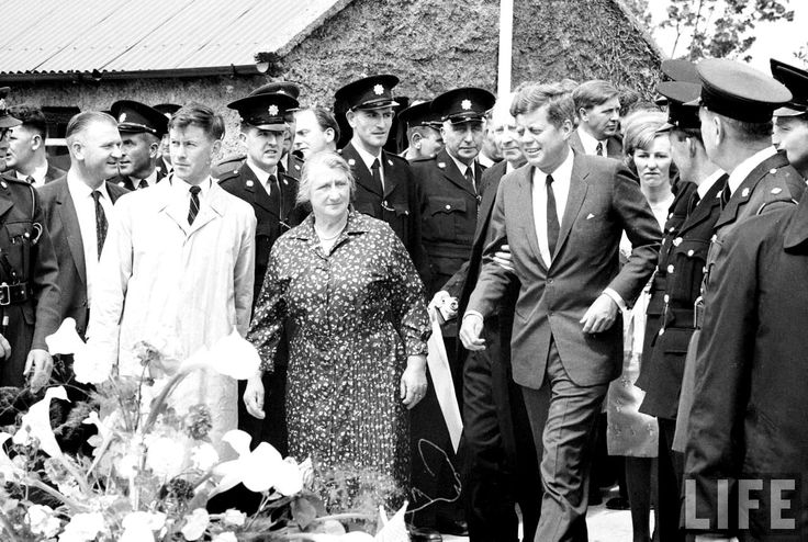 With Irish cousin Mary Ryan (floral print) looking on, US President John F. Kennedy (3R) prepares to say a few remarks during a visit to his ancestral hometown.Dunganstown, Wexford, Ireland  1963 ❁❤❁❃❤❁❤✾❤✾❤❁❤❃ http://en.wikipedia.org/wiki/John_F._Kennedy http://en.wikipedia.org/wiki/JFK_in_Ireland  http://www.jfklibrary.org/JFK/JFK-in-History/John-F-Kennedy-and-Ireland.aspx