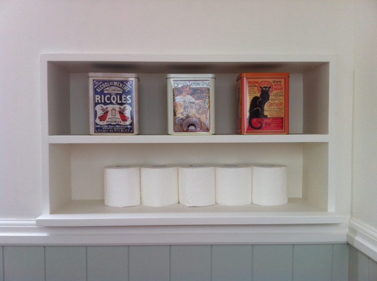 Recessed shelving for spare supplies - I found some pictures of recessed shelving in a magazine and I just had to have some - luckily I had an understanding builder who made three of them!  This one, opposite the toilet, has room for some vintage French tins and a few extra rolls