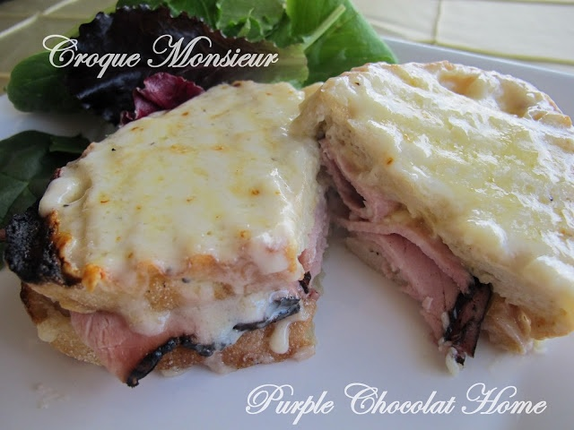 Croque Monsieur Recipe  (Adaptation of Ina Garten's recipe)  Makes 8 large sandwiches  Mornay Sauce   2 T. butter  3 T. flour  2 C. hot milk  1/2 tsp. salt  1/4 tsp. pepper  dash nutmeg  1/2 C. grated gruyere cheese  1/2 C. fresh grated parmesan cheese    Sandwich Ingredients    1/2 lb. sliced Black Forest Ham  4 C. grated gruyere cheese  16 slices of thick sliced crusty bread
