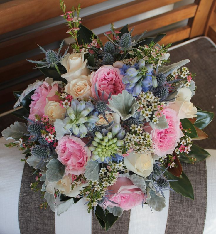 Beautiful Rustic / Vintage inspired Wedding Bouquet of David Austin Roses, Delphinium, Sea Holly, Roses & Geralton Wax. Created by Poppies and peas Floral Design