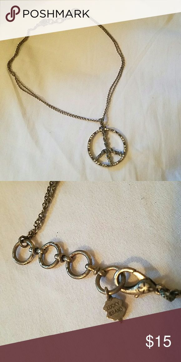 Lucky Brand necklace Peace sign Lucky necklace bought from their outlet! Lightly worn, length is on the shorter side. Lucky Brand Jewelry Necklaces
