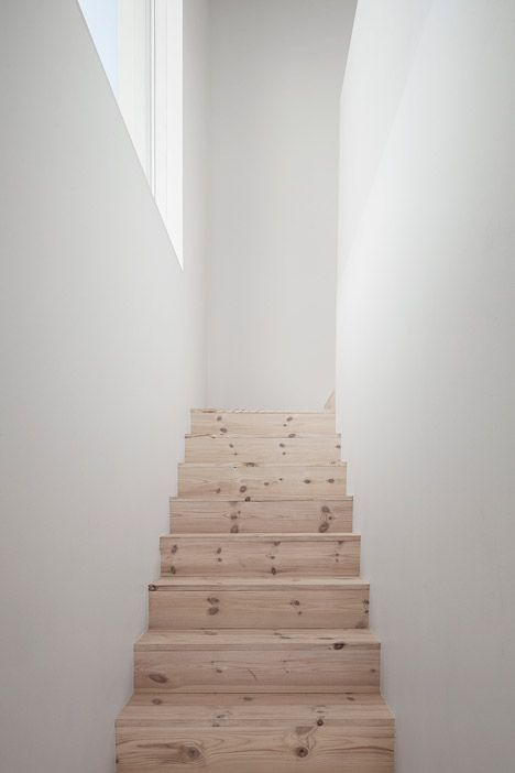 Wooden staircase inside a Swedish home situated in the countryside.