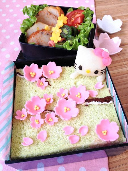 HELLO KITTY SAKURA BENTO A couple of days back, I baked a lovely matcha swiss roll decorated with sakura flowers made from gum paste. And since I still have extras of the gum paste sakura flowers left, I decided to use them for a fast breakfast character bento! http://en.bentoandco.com/blogs/news/9512679-hello-kitty-sakura-bento