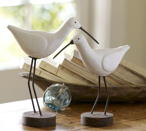 Decorative Accessories -- Ceramic Sandpiper Birds -- Seen chasing waves along seashores and wetlands worldwide, sandpipers are endearing icons of summer. We've captured their charm in a mix of hand-thrown terra cotta and rustic iron with a crackle-glaze finish.