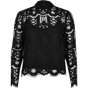 Zwarte hoogsluitende kanten blouse