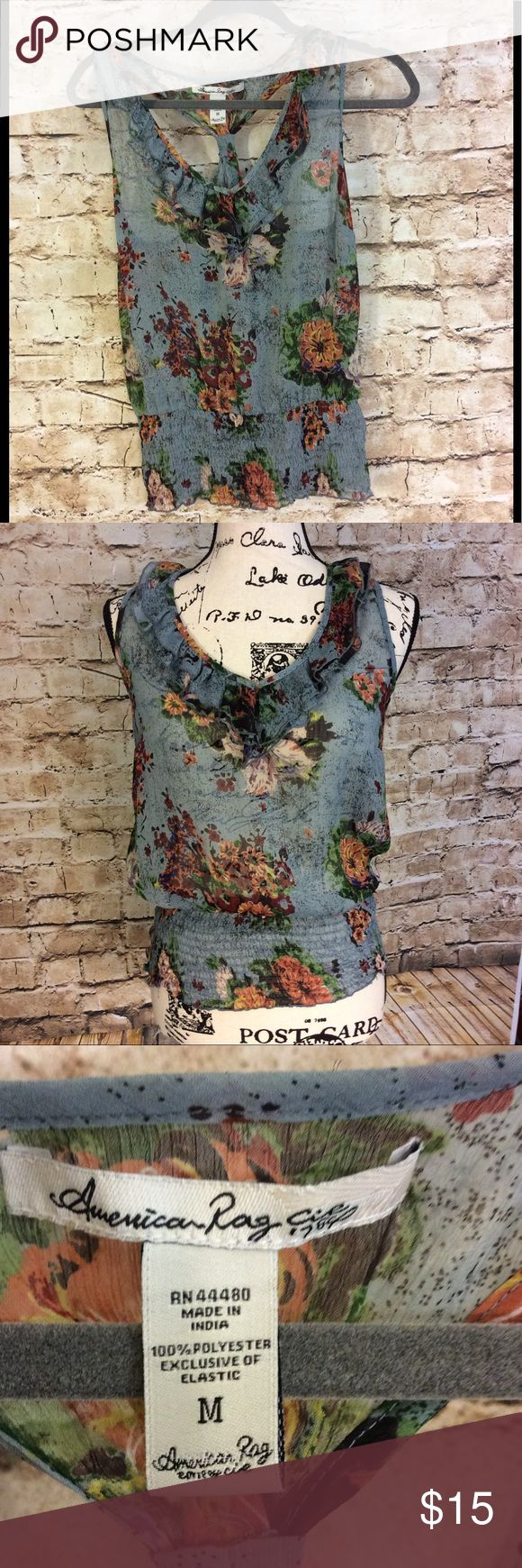 American rag sheer floral v-neck floral top Gently used American rag V-neck racer back double ruffle at neckline elastic tube waist band Sheer Length from top to bottom is 24 inches Armpit to armpit 17 inches Waist  14 stretches up the 21 Inches American Rag Tops Crop Tops