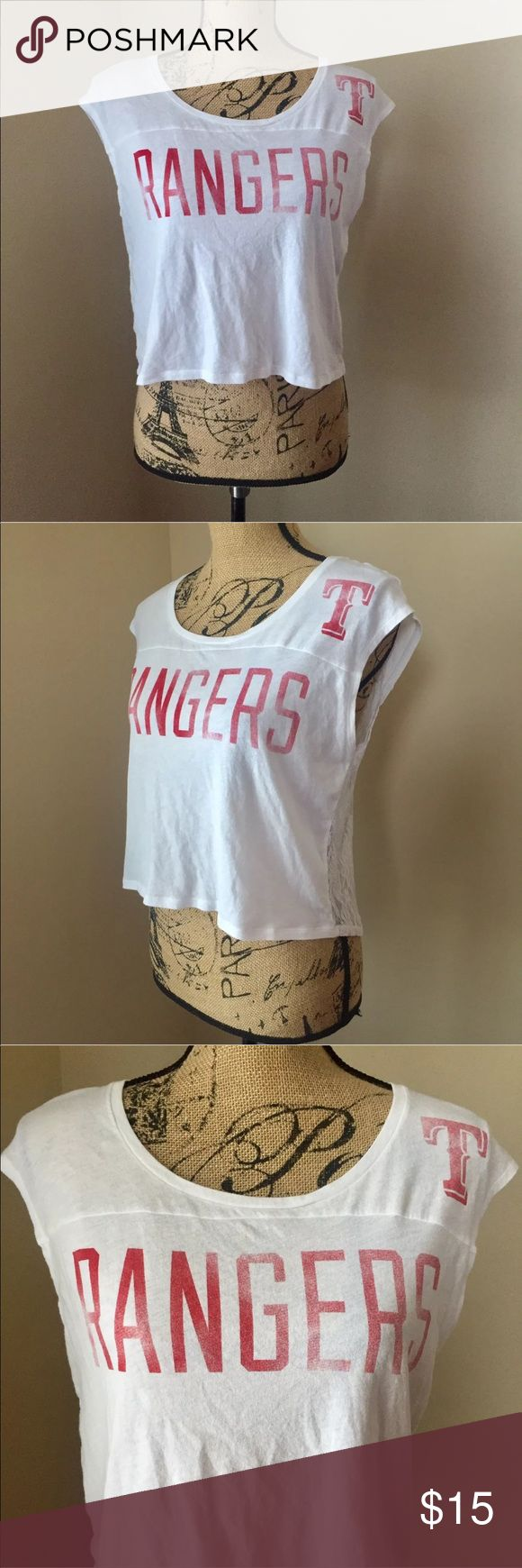 """Victoria Secret Pink 5th & Ocean Rangers Crop Top This Victoria Secret Pink Ranger blouse is in great, preloved condition. It is a size Extra Small, and still has plenty of life left. It is white with red lettering, reading """"Rangers"""" in the front. A """"T"""" for Texas on the top left. No sleeves, and mesh all throughout the back. Perfect for spring/summer weather and for baseball season! 5th & Ocean Tops Crop Tops"""