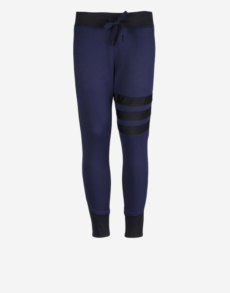 Blue track pants with the 3-Stripes stitched on, by Y-3.