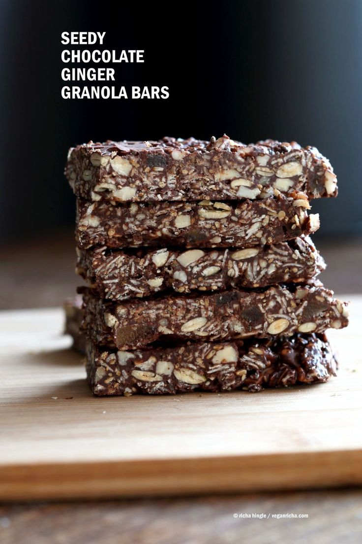 Seedy Chocolate No Bake Granola Bars with candied ginger and gingerbread spices. These bars filled will nuts and seeds make a tasty snack. substitute nuts with more seeds to make them nut-free. Vegan Gluten-free Recipe.