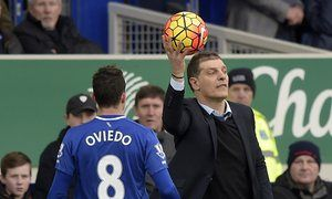 The West Ham manager, Slaven Bilic, catches the ball during the Premier League match against Everton