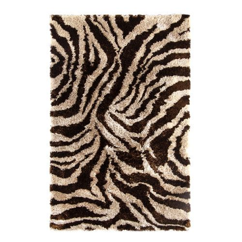 Features:  -Technique: Tufted.  -Material: 100% Polyester yarns.  -Construction: Handmade.  -Collection: Safari.  Technique: -Hand woven/Tufted.  Primary Color: -Black and Ivory.  Rug Shape: -Rectangl