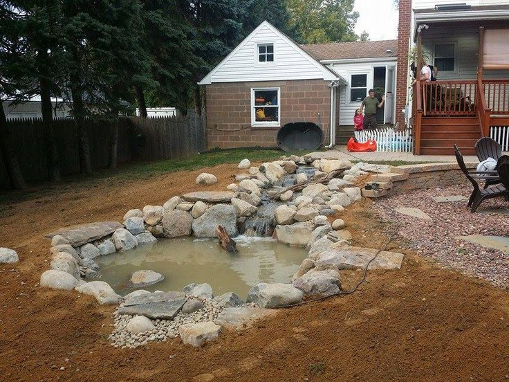 "We recently created a 'turtle oasis"" for our clients in Bucks County, Pa. #ponds #waterfalls #backyard #landscaping"