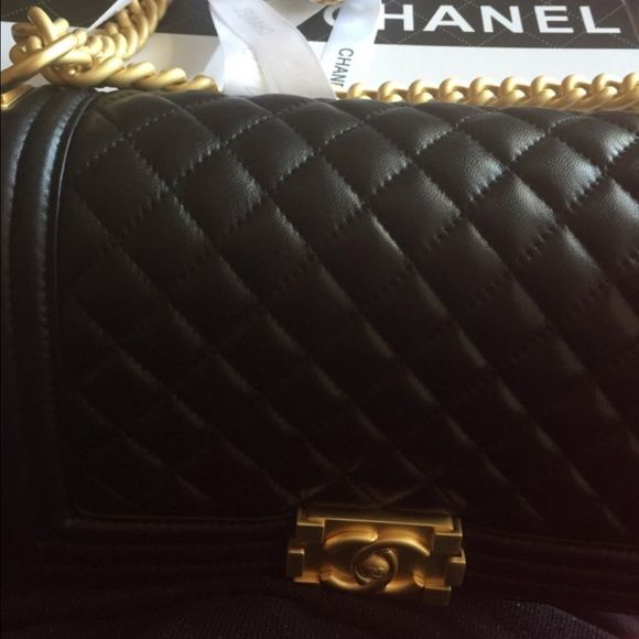Chanel Lé Boy Chanel chain link bag, matte gold color with genuine leather. Price reflects authenticity; worn only for after prom festivities. This is exact quality. Comes with box, cards, & brooch. CHANEL Bags Crossbody Bags