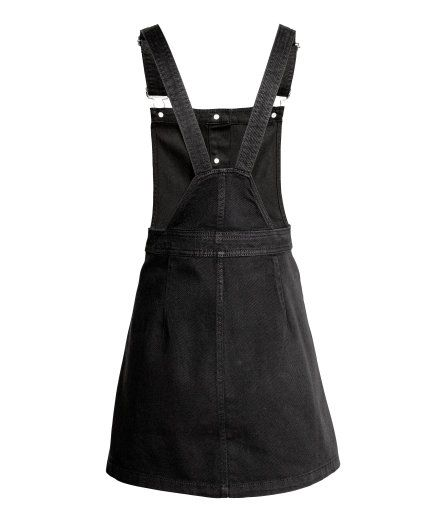 Check this out! Short bib overall dress in washed denim with adjustable suspenders, front pockets, and buttons at front. - Visit hm.com to see more.