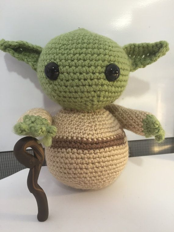 Love this item, you will! Handmade Crocheted Yoda doll, inspired by this pattern (http://www.ravelry.com/patterns/library/yoda-jedi-master-amigurumi). Doll measures approximately 6 tall. Attached cane is made from FIMA-type clay. Item is perfect for any little (or big!) Star Wars fan! Dolls are made upon order. Please allow 2-3 weeks for completion.