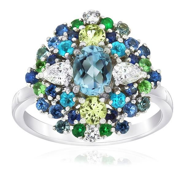 Be spellbound by this Cirque ring crafted in 18ct white gold and featuring chrysoberyl, tsavorite garnet, apatite, sapphire and aquamarine…