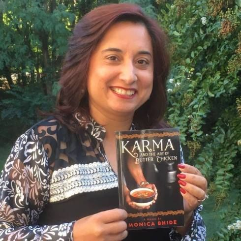 Monica with her latest novel. Photo courtesy of the author.