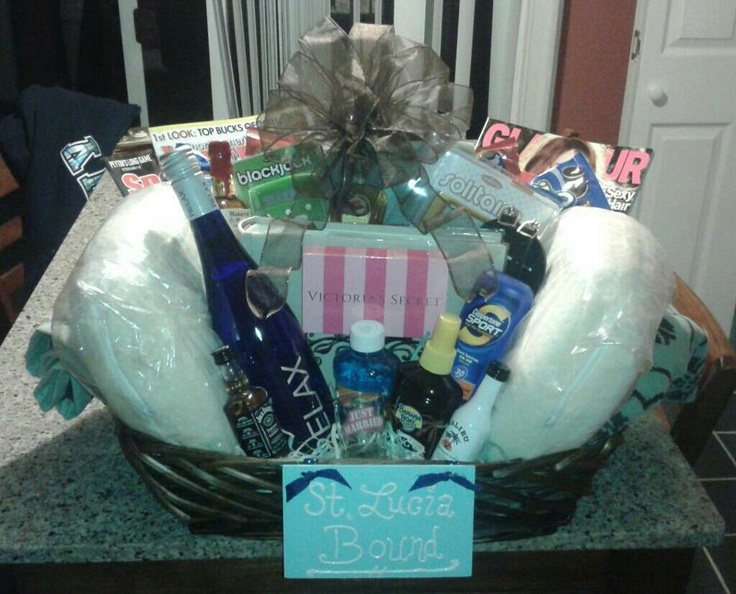 "The Honeymoon basket I made for my best friends bridal shower! Complete with: Towels, neck pillows, magazines (his and hers), snacks, a photo album, sunscreen/aloe, a VS gift card, lots of airplane bottles and a ""just married"" shot glass!!"
