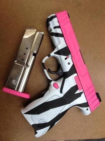 Zebra print hand gun!!! im not one for girly guns, but I like this one.