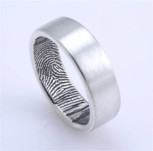 Custom Wedding band for him, with her fingerprint inside :)