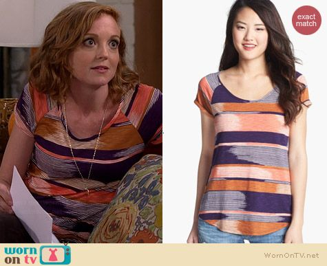 Debbie's purple and orange striped tee on The Millers.  Outfit Details: http://wornontv.net/38726/ #TheMillers