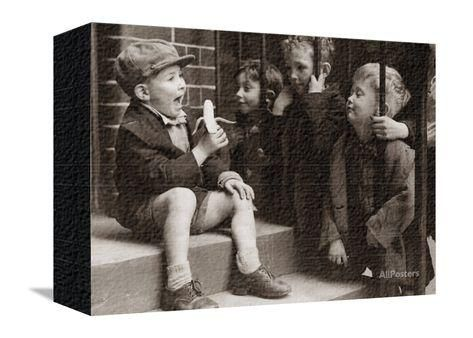 A Little Boy Holding a Banana Whilst Other Children Gaze Longingly at It Stampa fotografica su AllPosters.it