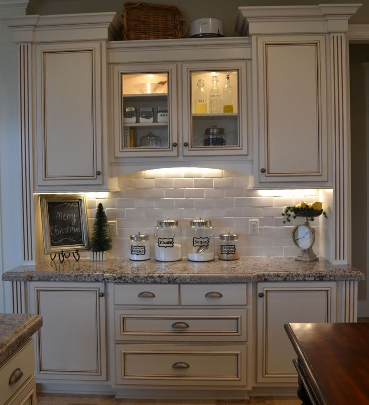 """Baking Center"" type of area.  The little valance in the middle & some of the cabinets being pulled out from wall just a bit make a difference."