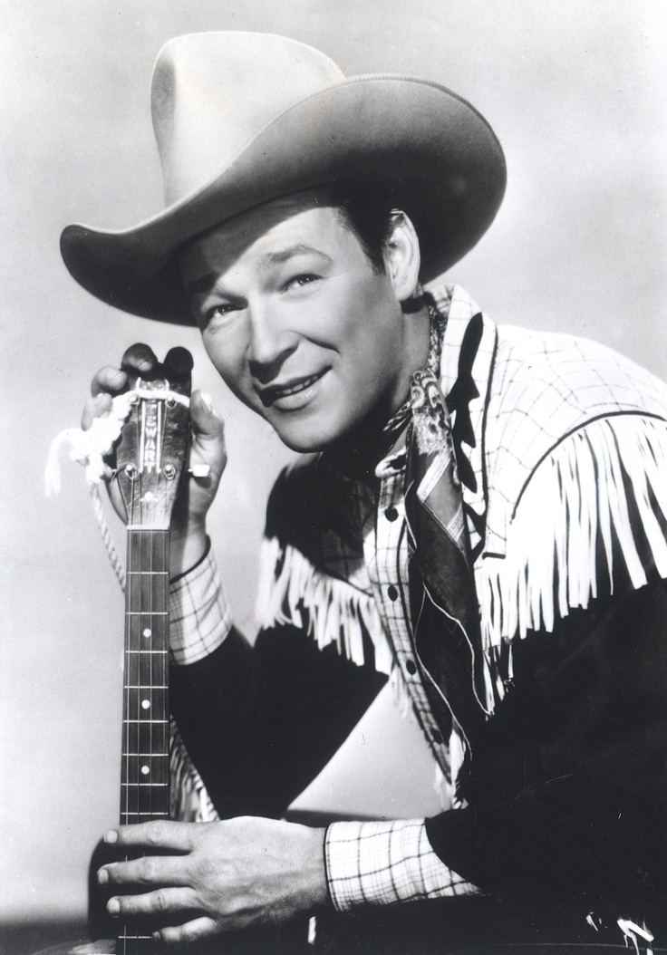 Roy Rogers, born Leonard Franklin Slye in Cincinatti, Ohio, was an American singer and cowboy actor, one of the most heavily marketed and merchandised stars of his era, as well as being the namesake of the Roy Rogers Restaurants franchised chain. He and his wife Dale Evans, his golden palomino, Trigger, and his German Shepherd dog, Bullet, were featured in more than 100 movies and The Roy Rogers Show.