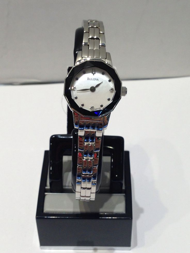 Ladies Bulova white with black rim dial and crystals
