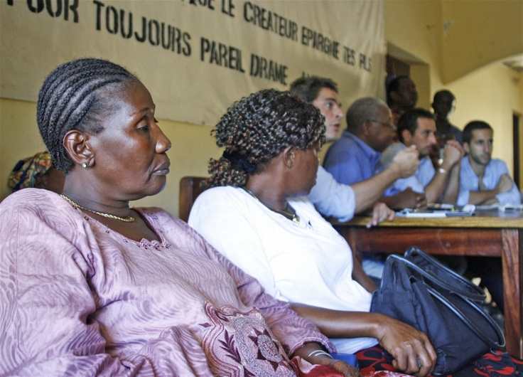Members of International Federation for Human Rights, which is helping victims to bring perpetrators to justice, speak with survivors of the 28 September attack