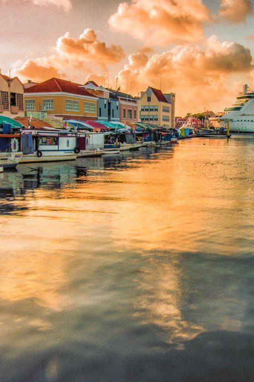 Willemstad, Curacao | The largest of the six Netherlands Antilles islands, Curacao combines historic, Dutch-influenced architecture with natural wonders such as caves, a beautiful rugged coastline, and spectacular cliffs.