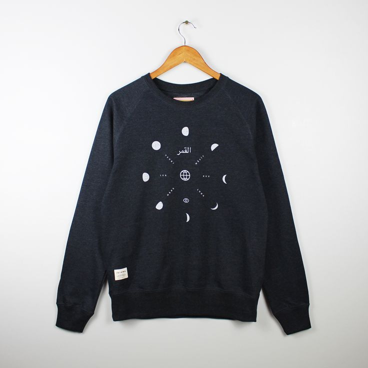 Idioma Ltd  Black Recycled Moons Sweatshirt : For this sweatshirt we took the 29.5 day moon cycle and broke it down to make a graphic of the moon every 3rd night. The moon has some beautiful names around the world, our favourites came from Arabic, Czech, Japanese, Italian, Portuguese, Finnish and Swedish. Designed and printed in the UK and manufactured using sustainable energy from wind and solar power.