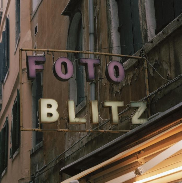 ITALY. Venice. Sign advertising a photography shop.   Peter Marlow
