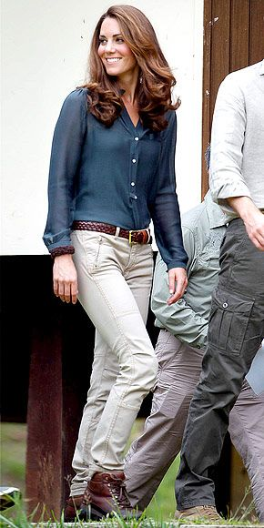 What does a Duchess wear to climb trees in the rainforest of Borneo? A navy button-up, fitted khakis, a brown belt and rugged hiking boots, natch! Apparently Prince William (not pictured) liked the look because he wore a very similar outfit.