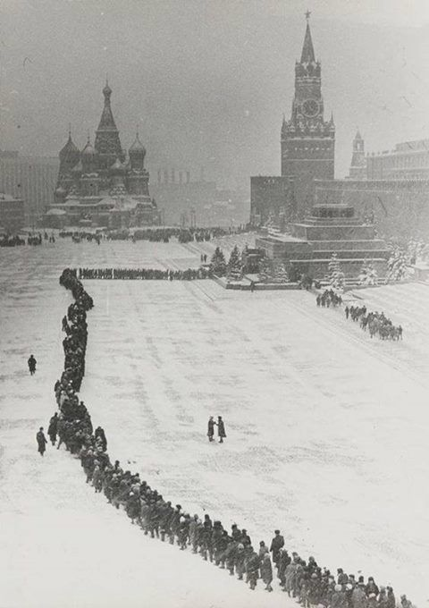 This vintage photo depicts a long queue to get in a Lenin's Mausoleum [ in Russian 'Мавзолей Ленина' or 'Mavzolei Lenina').  The body or Vladimir Lenin, the Father of the Revolution, was put there after his death in 1924!  If you do wish to visit him you have to go without bags and cameras - no filming inside. Visitors are kept moving, so you only get to spend a few minutes inside the mausoleum before you're hurried out by the guards. #learnrussian #studyrussian #russianlanguag