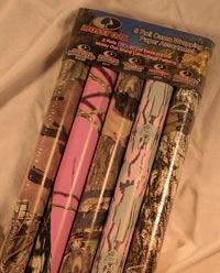 Mossy Oak Five Piece Camo Gift wrap... Now how do I wrap presents without this... I need some of this stuff...