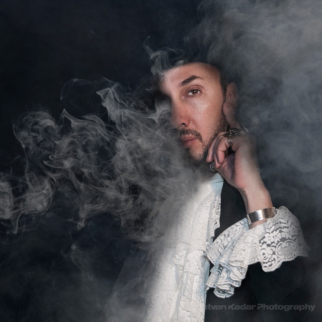 Reveal the other half behind the smoke. A dynamic and subtle effect that won't call immediate attention to the outfit.