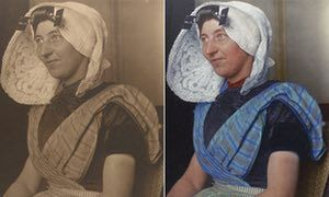 Dutch woman circa 1910 wearing a large bonnet that is one of the most recognizable aspects of Dutch traditional dress. It was usually made of white cotton or lace and sometimes had flaps or wings, and often came with a cap