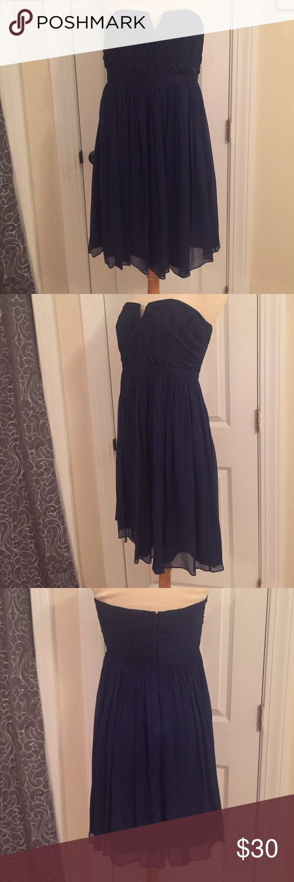 Navy chiffon dress Strapless with built in bra. J.Crew knee length lined chiffon dress. Flattering fit. Worn once. J. Crew Dresses Midi
